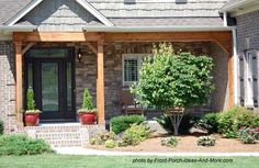 Small front porch with both gable and shed roofs supported by rustic wood beams and columns. Front-Porch-Ideas-and-More.com  #frontporch