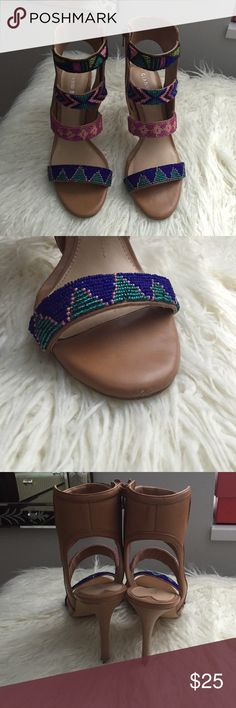 Pre owned Gianni Bini high heel sandals Pre owned. Worn a few times. All leather multi beaded high heels. Zippers on the side. See pics for signs of wear. Does not come with box. Size 8 and fits true to size. They were purchased from Dillard's. Gianni Bini Shoes Sandals