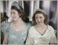 An 18-year-old Elizabeth (l.) wears a crown fit for a princess while attending a royal pantomime at Windsor Castle with her younger sister, Princess Margaret, on Dec. 22, 1944.