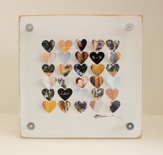 using wedding invites, photos of us, newspaper print, heart with out initials, and a heart with our wedding date on it, etc., use a heart punch, fold hearts in half, and attach to a matt for a 3d frame. i like this idea for our first wedding anniversary gift (paper). <3