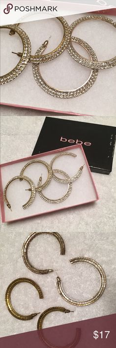 2 Pairs Of Bebe Hoop Earrings Worn a handful of times each with no missing stones. One set is gold colored and the other is silver color. Box included but it has some wear. Open to offers but sorry no trades. Bebe Jewelry Earrings