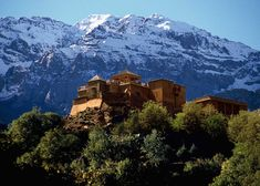 On a hilltop high in the Atlas Mountains, Kasbah du Toubkal is a tribute to Berber culture and hospitality built upon the ruins of an ancient Kasbah.