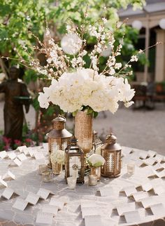 Escort Card Table | Beautiful Tall Centerpiece | Briana Marie Photography |  Floral Design: Fleurs de France |   See the wedding on SMP: http://stylemepretty.com/2013/07/05/sonoma-wedding-from-briana-marie-photography/