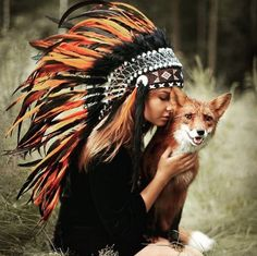 'Long live the reckless & the brave' Orange Indian Headdress in stock and for SALE in our online shop (89.- USD). Love how the color of the feathers clash with the fur of the fox...