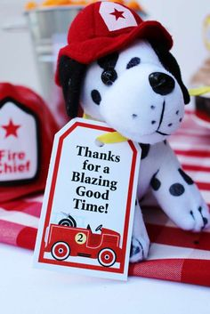 Adorable puppy favors at a firefighter birthday party! See more party ideas at CatchMyParty.com!