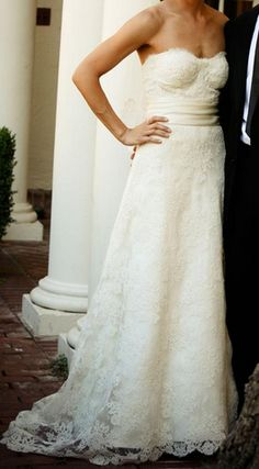 Monique Lhuillier Angelina Ivory Lace Wedding Gown. Britanny rocks strapless and this dress is beautiful.