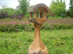 oakwood bird feeder chainsaw woodcarving. vogelvoederhuisje op beeldighout.nl