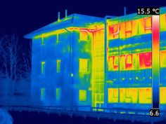 Image shows heat loss from the old (right) part of the building compared to newer section with improved thermal transmittance characteristics.