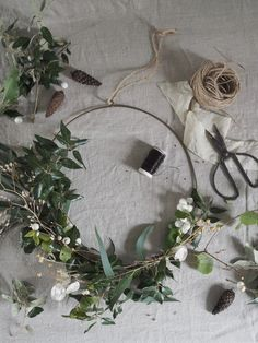 A minimalist Christmas wreath can add a simple, festive flourish of greenery to a space. Here's a tutorial on how to style a ring hoop two different ways Before Christmas, Christmas Time, Xmas, Pine Branch, Tree Branches, Cut Flowers, Dried Flowers, Minimalist Christmas, Wire Wreath