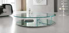 A modern coffee table design in an oval shape. The Gliss coffee table is available with a stainless steel or glass top. Coffee Table Design, Contemporary Glass Coffee Tables, Modern Coffee Tables, Glass Furniture, Unique Furniture, Contemporary Furniture, Furniture Design, Furniture Showroom, Furniture Stores