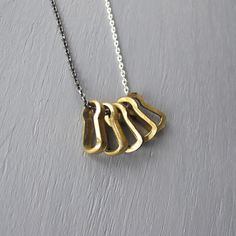 http://www.axandapple.com  Vintage brass key hole inserts on a cool mix of silver and gunmetal diamond cut curb chain.