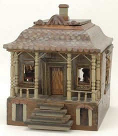 Late 19th century painted wood folk art one room doll house with colorfully painted shingle roof, front porch with turned posts , painted base with attached stairs, removable roof reveals attic.
