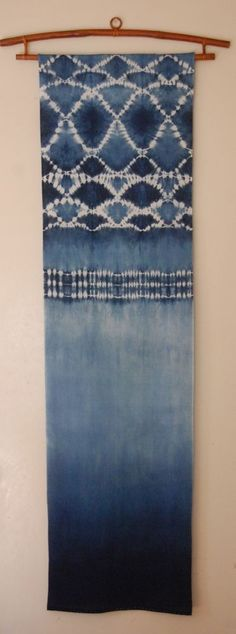 """13.5 x 50 """" indigo shibori on cotton mounted on a bamboo textile hanger from indonesia or vietnam...can't remember. can be purchased with ..."""