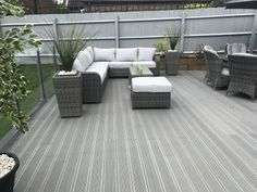 Photo gallery of Battleship Grey wood plastic composite Smartboard decking. Wpc Decking, Composite Decking, Outdoor Decking, Patio Deck Designs, Patio Design, Grey Gardens, Coastal Gardens, Outdoor Gardens, Fence Paint Colours