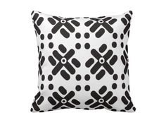 """This """"Teku"""" print black and white pillows looks great against a bold couch, chair or bedspread."""