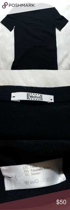 Wolford scoop neck black size large shirt Wolford scoop neck black size large  62% cotton 35% polyamide nylon 3% elastane No holes stains or pilling Has a slight shiny Sheen Armpit to armpit flat lay measures 17 in with stretch Shoulder seam to hem measures 25 in #207 Wolford Tops