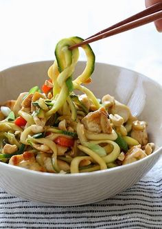 You can enjoy these Kung Pao Noodles without the guilt (under 300 calories), because I replaced the noodles with zoodles (zucchini noodles) and the results were fantastic!! Each bowl is filled with chicken and vegetables and the sauce has the flavor combination of of salty, sweet, sour, and spicy flavors. Topped with crushed peanuts – it's pretty hard to pass this up! If you're spiralizer has more than one spiral blade, use the thicker setting to replicate a thicker noodle feel. I tested...