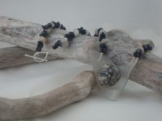 Polished Lake Ontario rock on recycled glass necklace