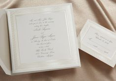 This bright white square invitation is stunning with an intricate etched border in crystal foil.