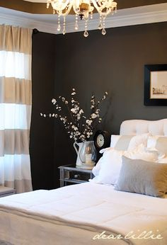 First, I love this bedroom. But I really love the wall color... Kendall Charcoal by Benjamin Moore. We are doing this in our black & white bathroom this month :)