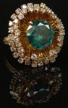 4.50 Carat Round Brilliant Cut Teal Blue Diamond, Round Brilliant Cut Diamond and 14 Karat Yellow Gold Ring. Naturally Enhanced Blue Diamond with Vivid Saturation of Color, VS2 Clarity, Round Brilliant Cut Diamonds F-G Color, VS1-SI1 Clarity.