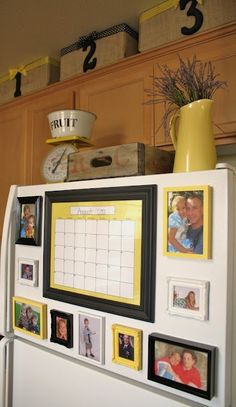 Looks much better than pictures hanging w/ magnets – use dollar store frames, paint them and put magnets on the back. @ Home Decor Ideas