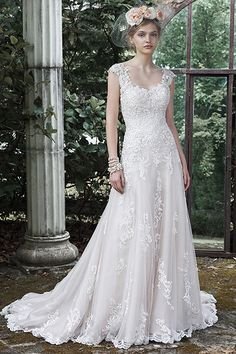 """""""Pear-shaped brides, try this Maggie Sottero dress on for size. The straps add balance to narrow shoulders, and the full swing of the A-line skirt disguises wide hips."""""""