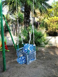 Baby swing from a plastic crate attached to swing set