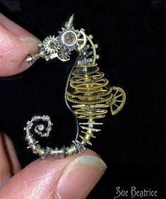 Seahorse made from old watch parts - Imgur