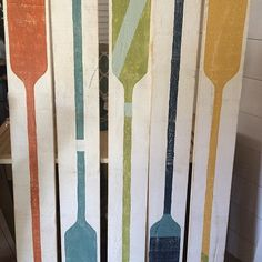 Have a long wall space? Empty space above a window? Here is your answer--- great colored oar wooden art. #nauticaldecor#beachydecor#seasidedecor