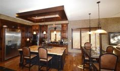 kitchen with wood cabinets crown molding in a vaulted ceiling room own room 22230