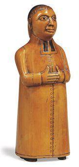 A BOXWOOD SNUFF MODELLED AS A CLERGYMAN early 19th century