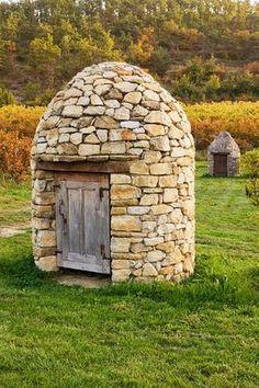 Stone well house in the vineyards, Domaine de la Verriere, France│ Clive Nichols