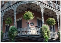 """""""Guardian Angel"""" - Signed Original Giclee Art Picture Print for Wall  Home Decor. A statue of an angel stands on a New Orleans' French Quarter balcony overlooking the streets below. Green ivy is growing in the planters. The decorative wrought iron railing here dates back almost a century."""