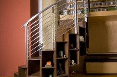 Spiral staircase created with storage. I love the idea of storage incorporated into the staircase. Stair Shelves, Staircase Storage, Stair Storage, Staircase Bookshelf, Display Shelves, Shelving, Spiral Staircase, Staircase Design, House Stairs