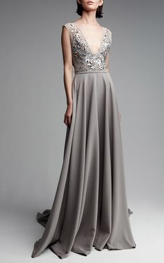 This **Georges Hobeika** gown features a deep v-neckline, an embellished bodice, and a flowy skirt.