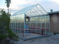 Building our Harbor Freight 10' x 12' Greenhouse: Part Six: Adding the Panels