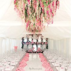 Tented wedding with amazing floral chandeliers