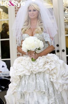 Real Housewife of Atlanta, Kim Zolciak's first wedding dress - a handmade Baracci gown made of duchess satin and embellished with Swarovski crystals, pearls and embroidered lace.