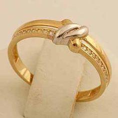 Złoty pierścionek z plątanym białym złotem imitacją dwóch fal