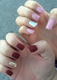 Matte burgundy and gold / glossy pink and silver short squoval acrylic nails.