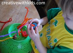 Pipe Cleaners, Beads and a Collander    This is a great fine motor skills activity. Your toddler can push pipe cleaners into the holes, then try stringing beads onto to pipe cleaners.