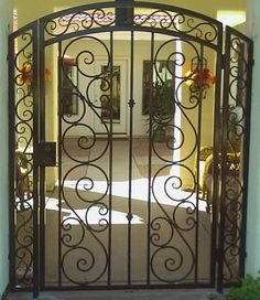 pics of front door security iron gates | The Beauty Of A Wrought Iron Railing