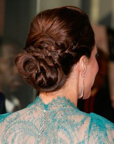 Love the Duchess Kate's braided updo!  1) The top part of her hair was pulled back and pinned around ear-height.    2) Then two thin pieces on either side of her head were braided and crossed over each other over the pins from step 1.    3) The rest of her hair was loosely braided about half-way down.    4) And finally, it was coiled into a soft bun and pinned.
