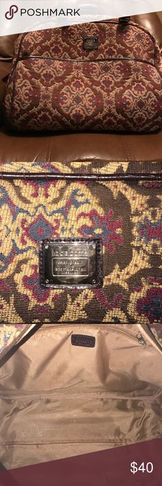 Liz Claiborne carry on bag This is a very nice carry on/duffle bag. Has handle with rolling wheels easy open and a lot of room. Liz Claiborne bag!!! Liz Claiborne Bags Shoulder Bags