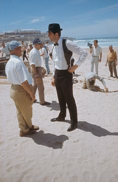 Australian actor George Lazenby films a scene for the James Bond movie 'On Her Majesty's Secret Service' on location on the Praia do Guincho. Aston Martin, George Lazenby, Bond Series, Extraordinary Gentlemen, Bond Cars, Australian Actors, James Bond Movies, Movie Facts, Bruce Lee