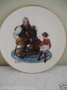 "Delightful Norman Rockwell Art Work  Grandpa's Girl ~ Little girl dancing for her Grandpa  Limited Edition ~ Danbury Mint ~ Fine China  Pre-Owned ~ Good Condition  Approx Size: 8.25"" diameter with gold trim  Information on plate on reverse  Nice collectible plate for your display case  or add a hanger for that bare spot on your wall"