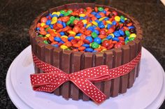 Little Birdie Secrets: candy cakes  It is two 8 inch round cakes frosted with kit-kats lining the outside and M on top. It was super easy, but looks so great!