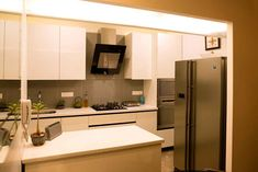 Large kitchen with marble countertop design by Shahen Mistry, Interior Designer in Mumbai, India