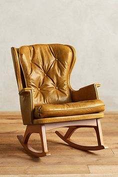 FOR TV ROOM - lets look for something like this in addition to the slipcovered seating - Leather Finn Rocker #anthropologie
